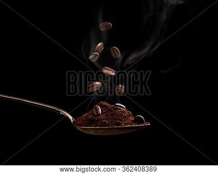 Steaming Roasted Coffee Beans In A Spoon On A Black Background