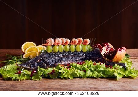 Sterlet Baked With Vegetables. Grilled Sturgeon Fish.