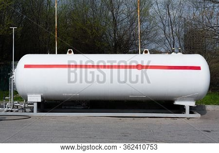 Propane. White Propane Gas Tank With Red Stripe (flammable Gas). Large Tank With Gas Filling Under P
