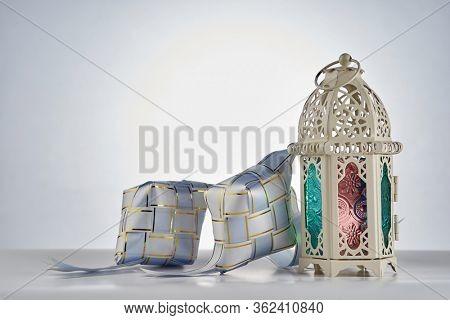 ribbon ketupat with islamic design decoration lamp on the white background