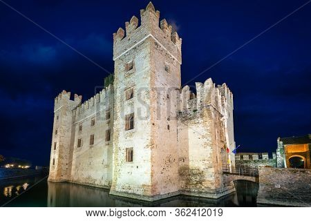 Scaligero Castle over the Garda lake in Sirmione at night, Italy