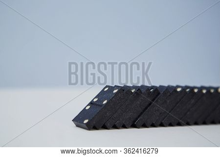 Total Collapse. Domino Effect Mockup. Black Planks Falling Down, Copy Space. Financial Crisis. Total