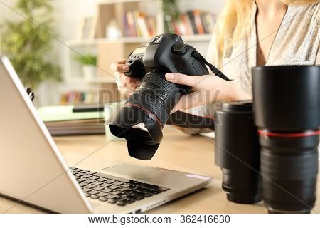 Close Up Of Photographer Woman Hands With Laptop Checking Dslr Camera On A Desk At Home