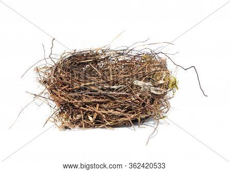 Isolated Bird's Nest Made Of Thin Branches To Lay Eggs And Breed Offsprings On A White Background.