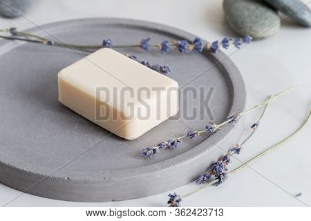 Minimal Picture With Sanitize Soap For Hand With Lavender Flowers At Stone Dish On White Background.