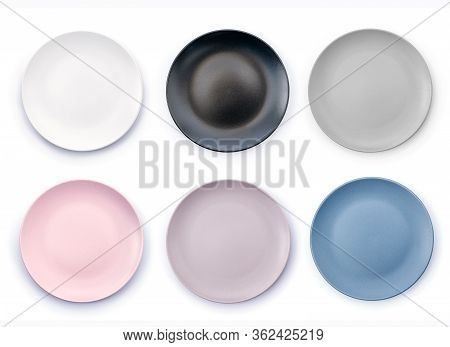 Set Of Six Colorful Empty Plates Isolated On White Background Top View. White, Black, Grey, Pink, Pu