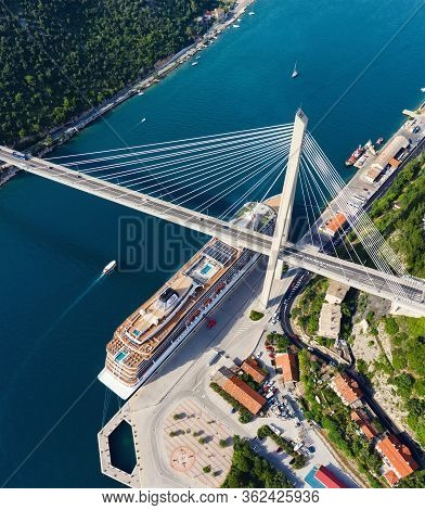 Aerial View At The Cruise Ship And Bridge In The Port. Adventure And Travel. Landscape With Cruise L