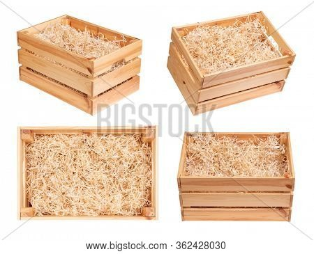 Wooden boxes with wood shavings isolated on white background