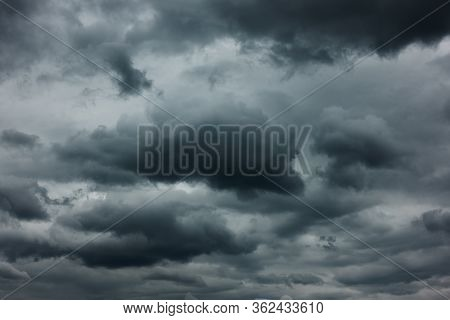 Dramatic sky with dark stormy clouds, may be used as background
