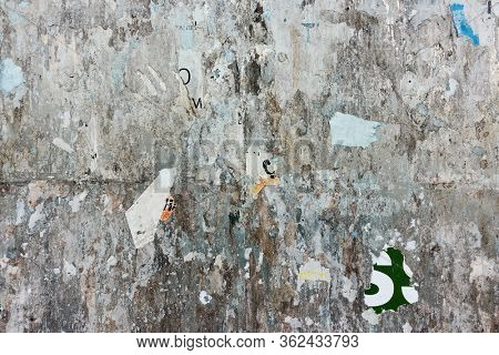 Street bulletin board with scraps of posters - Textured background with space for your own text or images