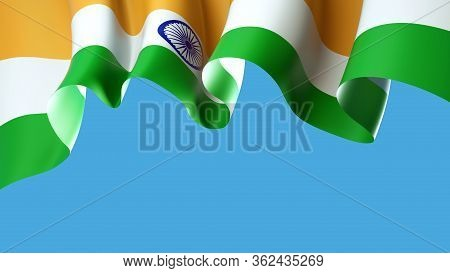 Waving India Flag On Blue Sky For Banner Design. India National Waving Flag Isolated On Blue Backgro