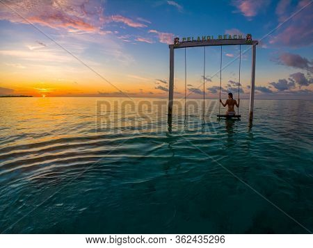 Girl On A Swing Tropical Sunset Gili Air Indonesia