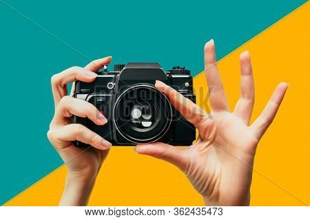 Vintage Camera In Female Hand. A Photo. Photographer. Manual Focus. Colored Background. Persian Gree