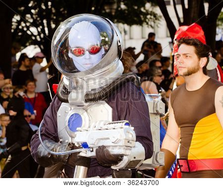 A comic book fan dressed as Mr. Freeze marches in the annual DragonCon parade