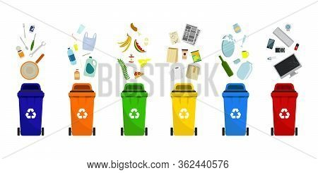 Plastic Trash Containers Of Different Types. Separation Of Waste In Trash Bins. Sort Waste For Recyc