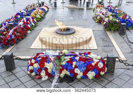 Paris, France - May 8, 2019: Flowers And Eternal Flame Near Arc De Triomphe In Honor Of Victory Over