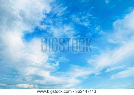 Sky landscape. Blue sky background. Picturesque colorful clouds lit by sunlight. Vast sky landscape panoramic scene - colorful sky view in bright tones
