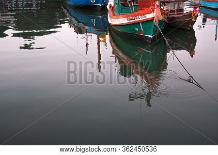Chon Buri, Thailand - February 16, 2019: Water Reflection Of The Local Fisherman Boat Mooring At Loc