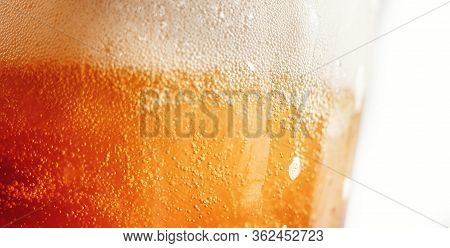 Close Up Gold Background Texture Of Yellow Lager Beer With Froth And Bubbles In Glass, Soft Focus
