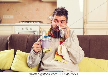 Man Get Flu, Having Runny Nose. Man Drinks Hot Tea During Sickness At Home.