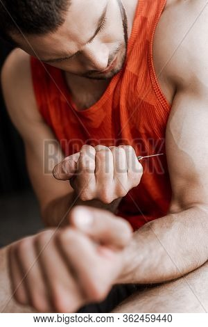 Selective Focus Of Sportsman Making Doping Injection