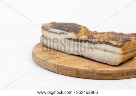 Smoked Bacon On The Round Wooden Board