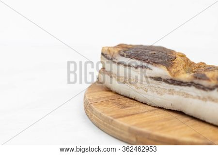 Smoked Bacon With Copy Space Above White Background