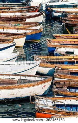 Wooden Vintage Boats. Countless Fishing Boats. Many Fishing Boats In The Port Of Naples In Italy. Ve