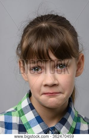 Portrait Of A Ten-year-old Girl With A Pitying Look, European Appearance, Close-up