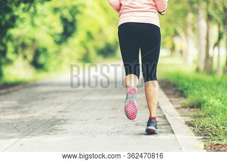 Healthy Woman Jogging Run And Workout On Road Outdoor. Asian Runner People Exercise Gym With Fitness