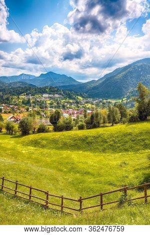 Stunning Alpine Landscape With Green Fields And Piatra Craiului Mountains In Dambovicioara Commune.