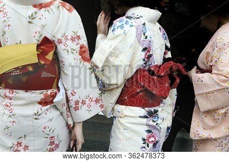 Nara, Japan - November 5, 2014: Geishas Wearing Kimonos, Selective Focus At The Leftgeisha.this Is A