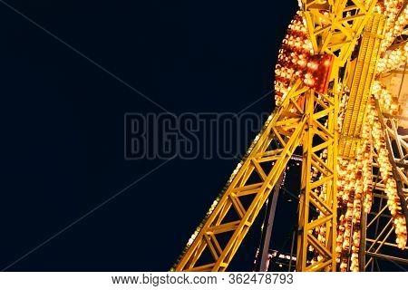 Close Up Of Ferris Wheel Attraction In  Amussement Park Of Odessa, Ukraine At Night Time .