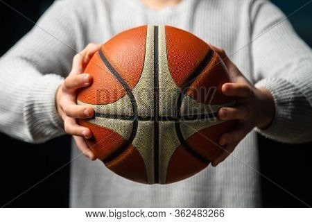 Close Up Of Professional Basketball Player Holding A Ball In The Hand. Street Basketball Athlete Pre