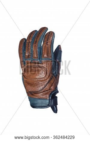 Motorcyclists Concepts. Closeup Of Modern Leather Tan Motorcyclist Protection Glove With Decorative