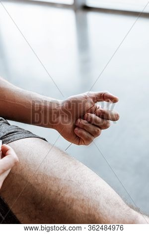 Cropped View Of Sportsman Making Doping Injection In Leg