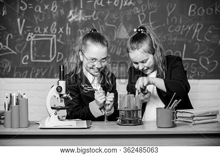 Science Experiments In Chemistry Laboratory. Little Scientist Work With Microscope. Biology Lesson.