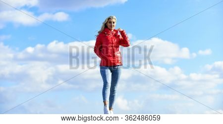 Fashion Outfit. Windy Day. Girl Red Jacket Cloudy Sky. Wind Of Changes. Female Psychology. Woman Fas