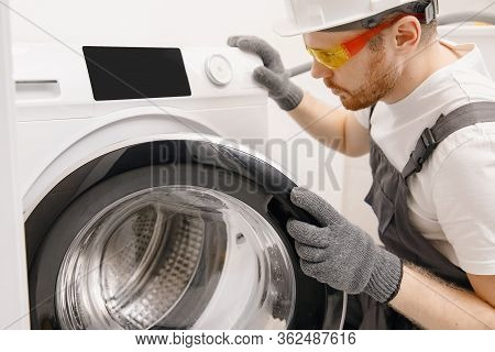 Plumber Repairing Washing Machine, Working Man Fixing Problem