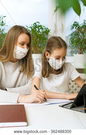 Schoolgirl With Her Mother At Distance Learning. Home Schooling Concept.