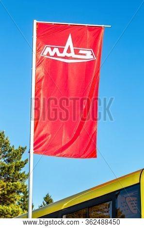 Samara, Russia - September 23, 2017: Dealership Flag Minsk Automobile Plant (maz) Over Blue Sky. Maz