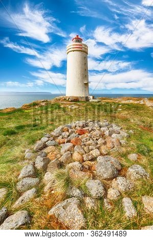 Stunning View Of Skarsviti Lighthouse In Vatnsnes Peninsula On A Clear Day In North Iceland. Locatio