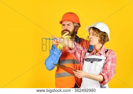 Renovation Concept. Family Counting Finances For Renovation. Couple Planning Changes Renovation Apar