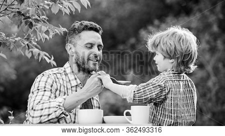 Natural Nutrition Concept. Feeding Son Natural Foods. Stage Of Development. Feed Son Solids. Dad And