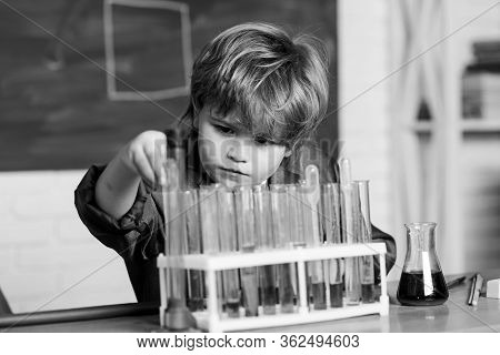 Genius Pupil. Chemical Analysis. Science Concept. Wunderkind Experimenting With Chemistry. Boy Use M