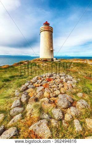 Stunning View Of Skarsviti Lighthouse In Vatnsnes Peninsula On A Sunny Day In North Iceland. Locatio