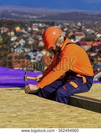Roofer Constructing New Roof. Construction Building. Waterproof Sheet Materials. High Altitude Works