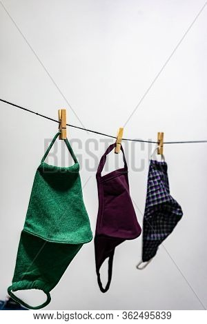 Washable Face Masks Hanging After Washing. Washable Face Masks To Help Reuse And To Protect From Bei
