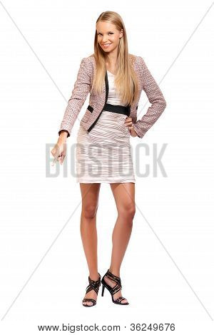 Elegant Blonde Woman Pointing Down On White Background