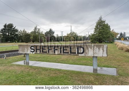 Sheffield, Canterbury / New Zealand, April 6 2019 : Sheffield Village Name Sign Beside State Highway
